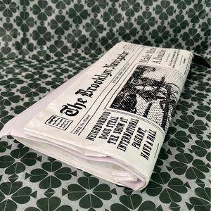 Kate spade newspaper clutch